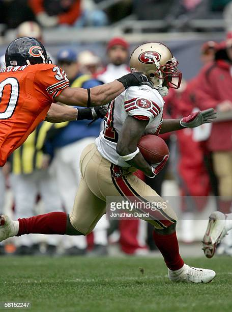 Running back Frank Gore of the San Francisco 49ers tries to get by safety Mike Brown of the Chicago Bears on November 13 2005 at Soldier Field in...