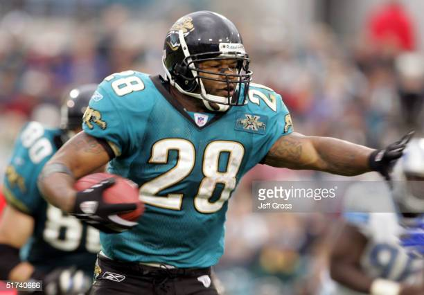 Running back Fred Taylor of the Jacksonville Jaguars carries the ball during the second half against the Detroit Lions at Alltel Stadium on November...