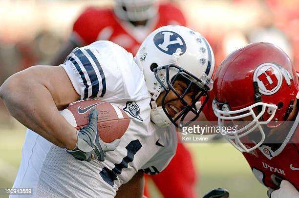 Running back Fui Vakapuna knocks helmets with Utahs Joe Jiannoni at Rice-Eccles Stadium in Salt Lake City, Saturday, Nov. 25, 2006. BYU defeated Utah...
