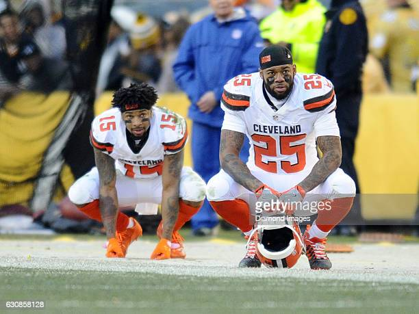 Running back George Atkinson III and wide receiver Mario Alford of the Cleveland Browns watch the action from the sideline during a game against the...