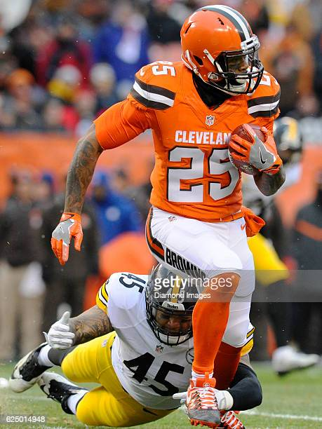 Running back George Atkinson III of the Cleveland Browns is tackled by fullback Roosevelt Nix of the Pittsburgh Steelers as he returns a kickoff...