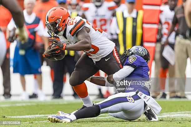 Running back George Atkinson of the Cleveland Browns is tackled by free safety Lardarius Webb of the Baltimore Ravens during the second half at...