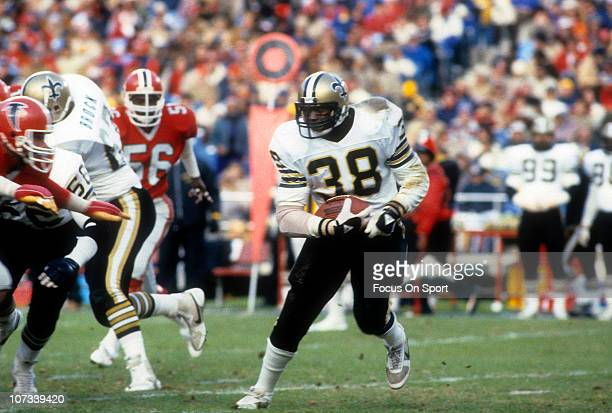 Running back George Rogers of the New Orleans Saints carries the ball against the Atlanta Falcons during an NFL football game at AtlantaFulton County...