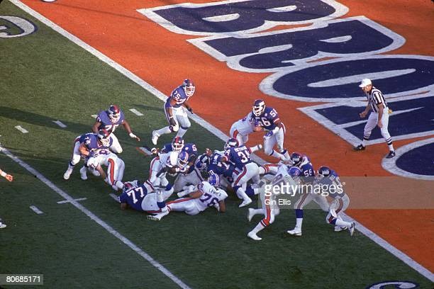 Running back Gerald Wilhite of the Denver Broncos is stacked up by linebacker Carl Banks of the New York Giants in Super Bowl XXI at the Rose Bowl on...