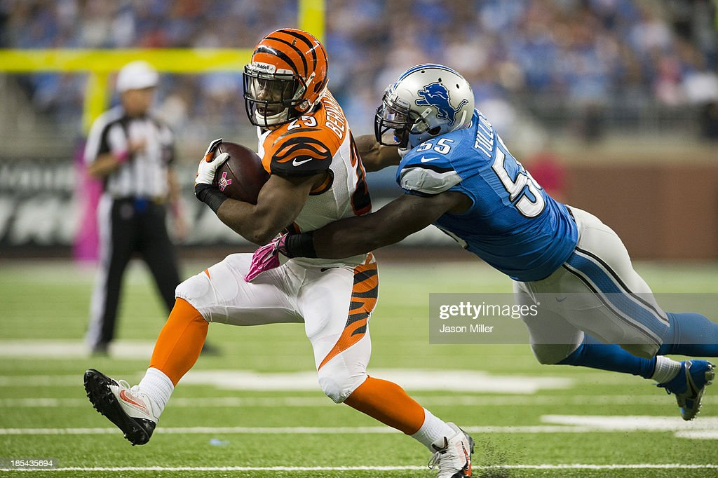 Running back Gio Bernard #25 of the Cincinnati Bengals is tackled by middle linebacker Stephen Tulloch #55 of the Detroit Lions during the first half at Ford Field on October 20, 2013 in Detroit, Michigan.
