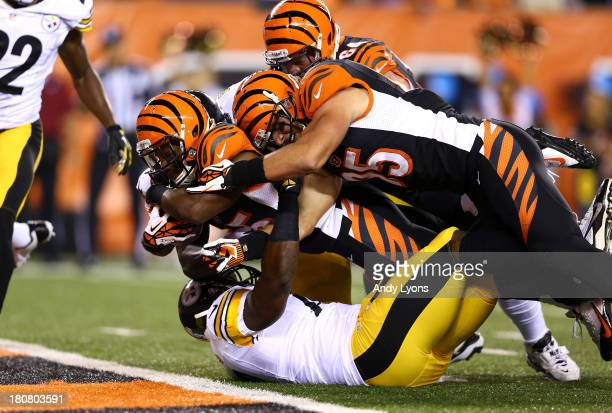 Running back Giovani Bernard of the Cincinnati Bengals dives into the endzone for a seven-yard touchdown run in the first quarter against the...