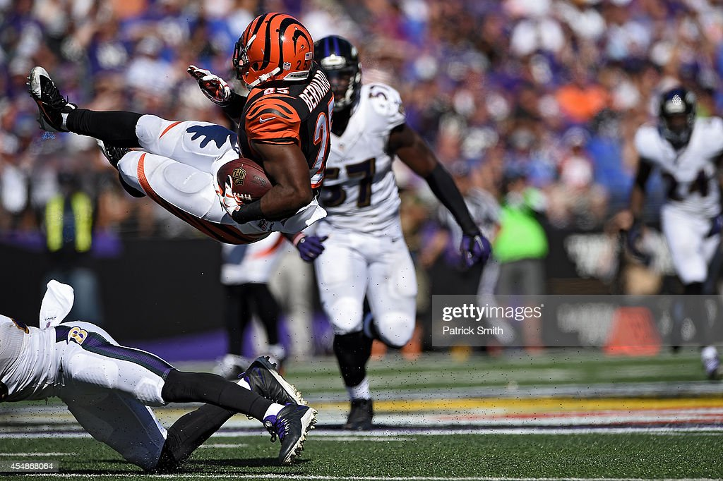 Running back Giovani Bernard #25 of the Cincinnati Bengals is tackled against the Baltimore Ravens in the fourth quarter at M&T Bank Stadium on September 7, 2014 in Baltimore, Maryland.