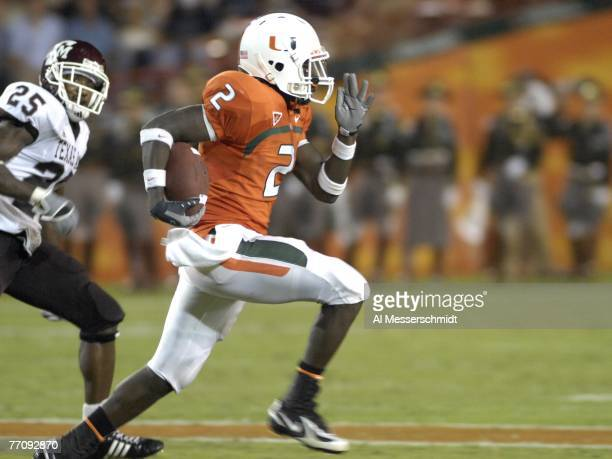 Running back Graig Cooper of the University of Miami Hurricanes rushes upfield against Texas A&M Aggies at the Orange Bowl on September 20, 2007 in...