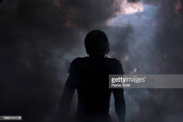 Running back Gus Edwards of the Baltimore Ravens is introduced before playing against the Oakland Raiders at MT Bank Stadium on November 25 2018 in...