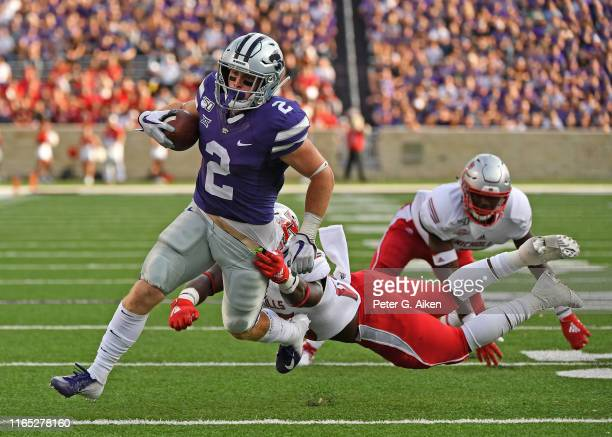 Running back Harry Trotter of the Kansas State Wildcats rushes for a touchdown against the Nicholls State Colonels during the first half at Bill...