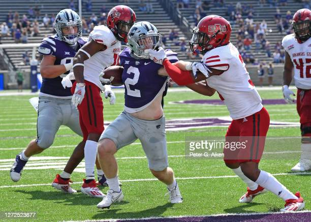Running back Harry Trotter of the Kansas State Wildcats rushes for a touchdown against safety Antwon Fegans of the Arkansas State Red Wolves, during...