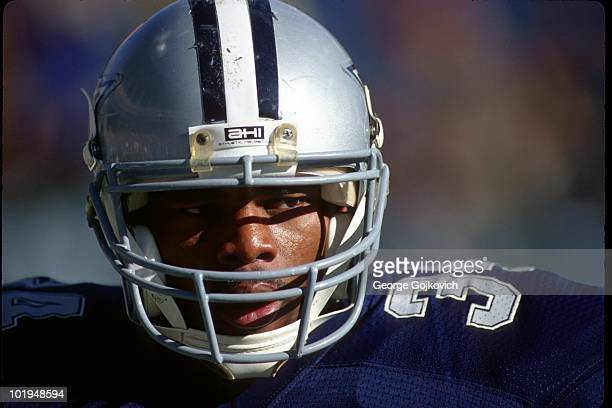 Running back Herschel Walker of the Dallas Cowboys looks on from the sideline during a game against the Cleveland Browns at Municipal Stadium on...