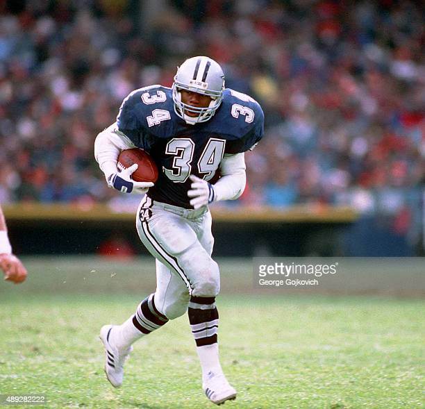 Running back Herschel Walker of the Dallas Cowboys runs with the football during a game against the Cleveland Browns at Municipal Stadium on December...