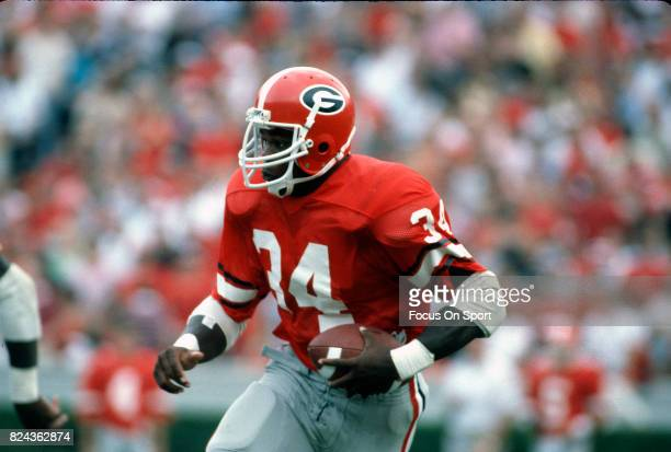 Running back Herschel Walker of the Georgia Bull Dogs carries the ball during an NCAA football game circa 1982 Sanford Stadium in Athens Georgia...