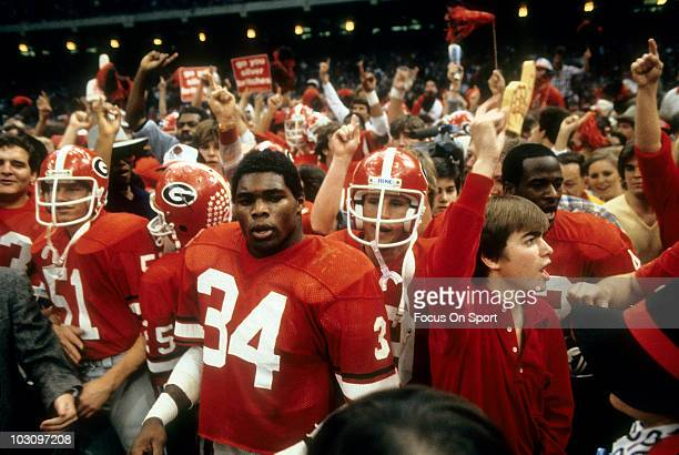 Running back Herschel Walker of the University of Georgia Bull Dogs surounded by teammates after the Bull Doges defeated the Notre Dame Fighting...