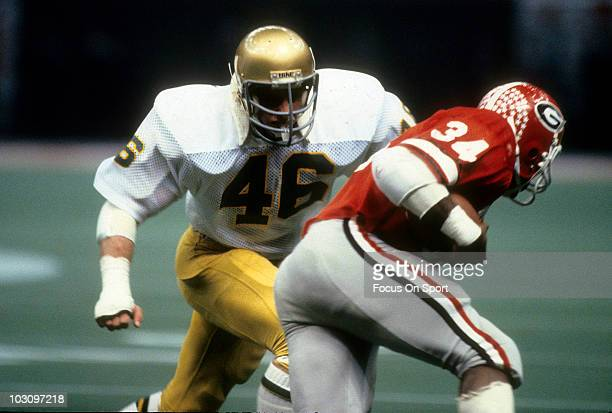 Running back Herschel Walker of the University of Georgia Bull Dogs carries the ball against the Notre Dame Fighting Irish during the Sugar Bowl game...