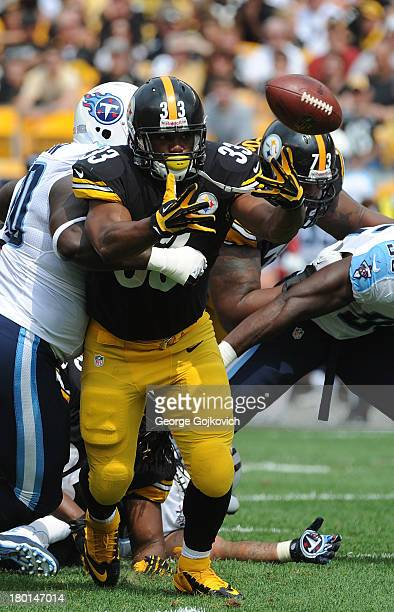 Running back Isaac Redman of the Pittsburgh Steelers fumbles the football during a game against the Tennessee Titans at Heinz Field on September 8...