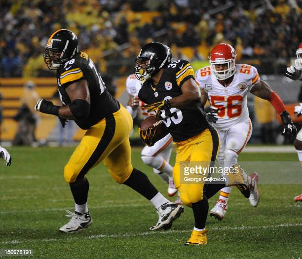 Running back Isaac Redman of the Pittsburgh Steelers runs with the football as offensive tackle Max Starks blocks and linebacker Derrick Johnson of...