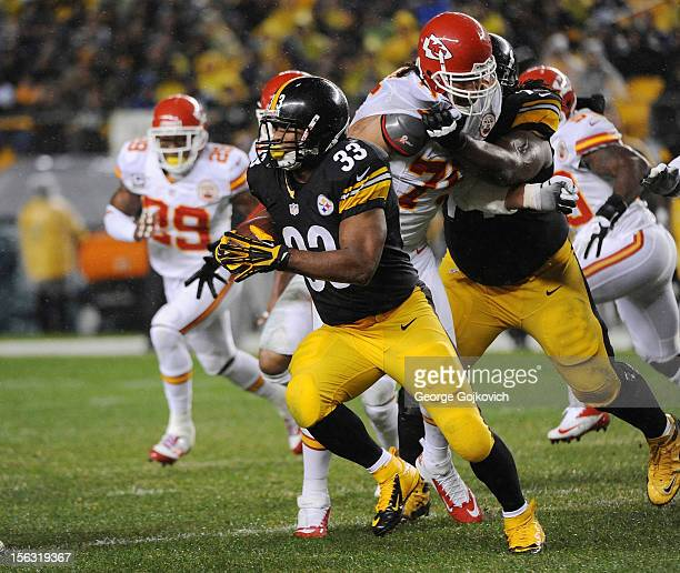Running back Isaac Redman of the Pittsuburgh Steelers runs with the football as offensive guard Willie Colon blocks defensive end Glenn Dorsey during...