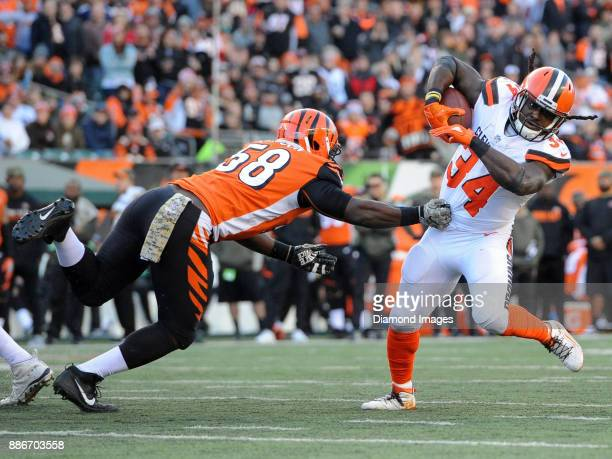 Running back Isaiah Crowell of the Cleveland Browns breaks the tackle of linebacker Carl Lawson of the Cincinnati Bengals in the fourth quarter of a...
