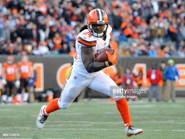 Running back Isaiah Crowell of the Cleveland Browns carries the ball in the fourth quarter of a game on November 26 2017 against the Cincinnati...
