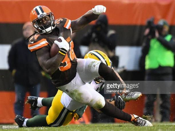 Running back Isaiah Crowell of the Cleveland Browns falls to the ground as he is tackled in overtime of a game on December 10 2017 against the Green...