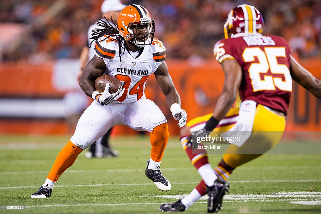 Running back Isaiah Crowell #34 of the Cleveland Browns for a gain while under pressure by defensive back Justin Rogers #25 of the Washington Redskins during the first half at FirstEnergy Stadium on August 13, 2015 in Cleveland, Ohio.