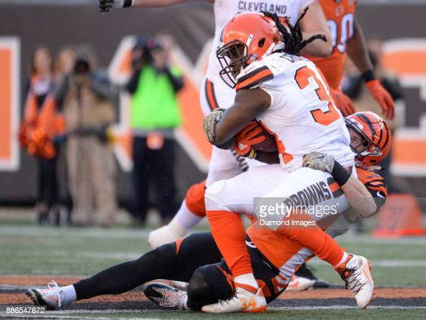 Running back Isaiah Crowell of the Cleveland Browns is tackled by safety Clayton Fejedelem of the Cincinnati Bengals in the third quarter of a game...
