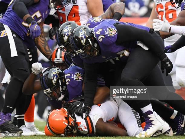 Running back Isaiah Crowell of the Cleveland Browns is tackled by defensive tackle Michael Pierce linebacker Matthew Judon and defensive tackle Carl...