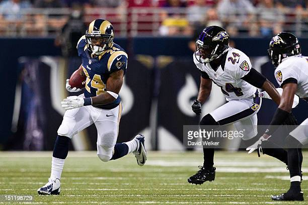 Running back Isaiah Pead of the St Louis Rams attempts to outrun defensive back Corey Graham of the Baltimore Ravens to the outside during the game...