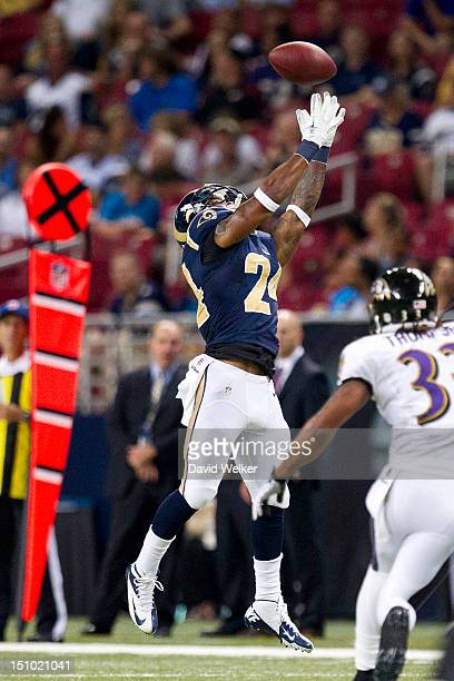 Running back Isaiah Pead of the St Louis Rams leaps to catch a pass during the game against the Baltimore Ravens at the Edward Jones Dome on August...
