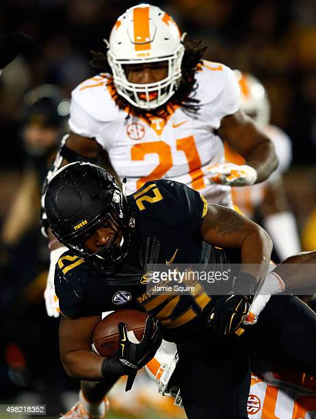 Running back Ish Witter of the Missouri Tigers carries the ball as linebacker Jalen Reeves-Maybin of the Tennessee Volunteers defends during the game...
