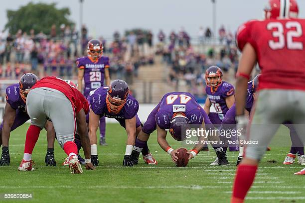 Running Back Ivo Schnberner of Samsung Frankfurt Universe ready to snap the ball for a field goal try from Defensive Back Ricardo Rodrigues of...