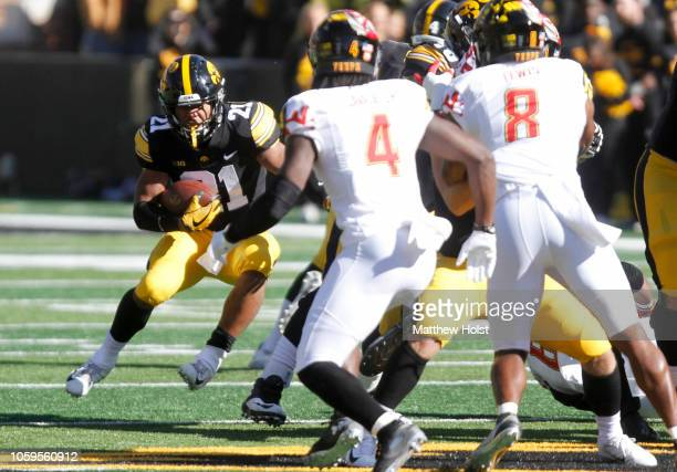 Running back Ivory KellyMartin of the Iowa Hawkeyes runs up the field during the first half against defensive back Darnell Savage of the Maryland...
