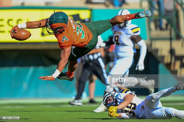 Running back Izzy Matthews of the Colorado State Rams leaps over safety Keifer Glau of the Northern Colorado Bears for a touchdown that was reversed...
