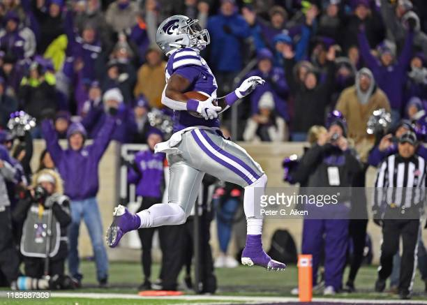 Running back Jacardia Wright of the Kansas State Wildcats rushes for a touchdown against the Iowa State Cyclones during the first half at Bill Snyder...