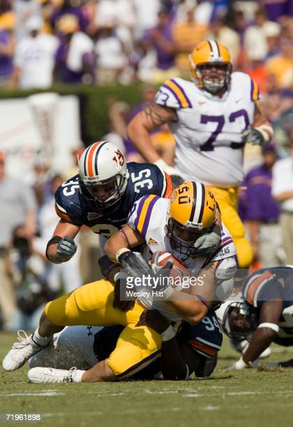 Running back Jacob Hester of the LSU Tigers gets tackled by the face mask by linebacker Will Herring of the Auburn Tigers during a game on September...