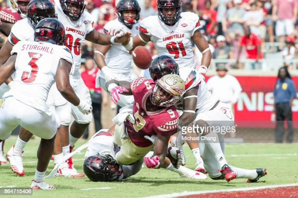 Running back Jacques Patrick of the Florida State Seminoles fumbles the ball at the goal line during their game against the Louisville Cardinals at...