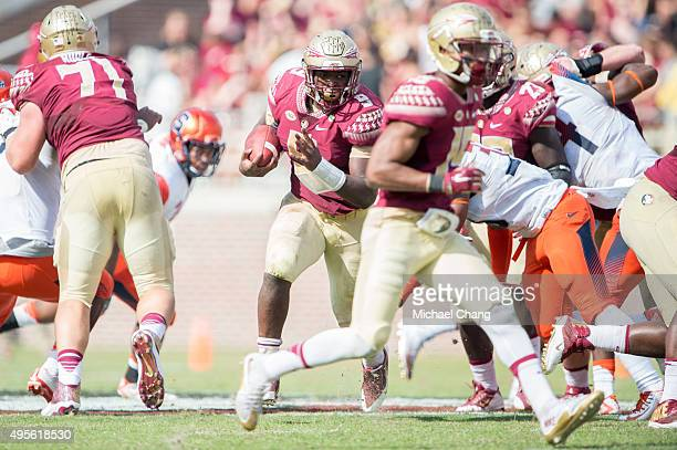 Running back Jacques Patrick of the Florida State Seminoles runs the ball through traffic during their game against the Syracuse Orange on October 31...