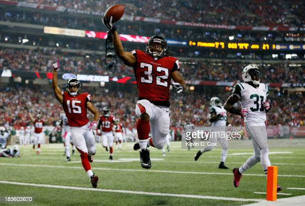 Running back Jacquizz Rodgers of the Atlanta Falcons scores his second touchdown of the game against the New York Jets during their game at the...