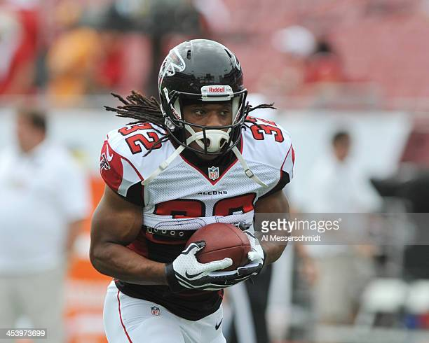 Running back Jacquizz Rodgers of the Atlanta Falcons warms up for play against the Tampa Bay Buccaneers November 17 2013 at Raymond James Stadium in...