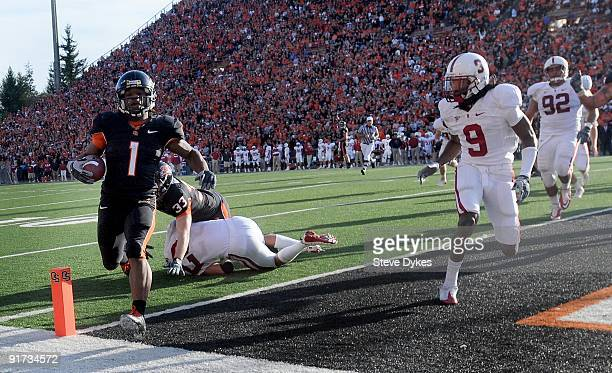 Running back Jacquizz Rodgers of the Oregon State Beavers crosses the goal line for a touchdown as cornerback Richard Sherman of the Stanford...