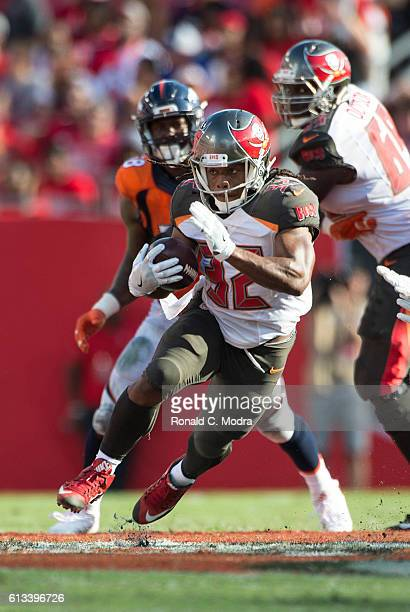 Running back Jacquizz Rodgers of the Tampa Bay Buccaneers carries the ball during a NFL game against the Denver Broncos at Raymond James Stadium on...