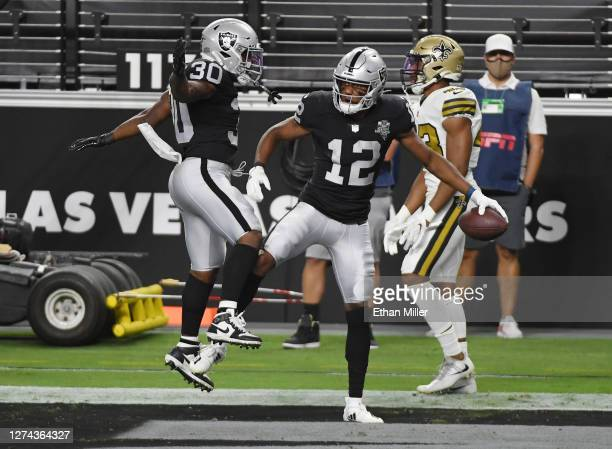 Running back Jalen Richard and wide receiver Zay Jones of the Las Vegas Raiders celebrate after Jones caught a touchdown pass against the New Orleans...