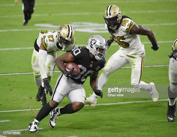 Running back Jalen Richard of the Las Vegas Raiders rushes for a 20yard touchdown against strong safety Malcolm Jenkins and outside linebacker...