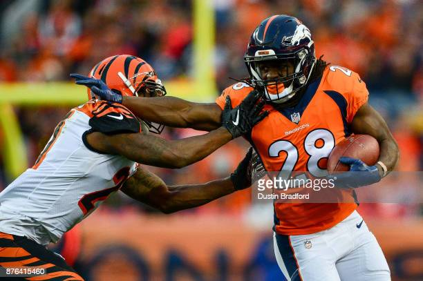 Running back Jamaal Charles of the Denver Broncos gives a stiff arm to cornerback Dre Kirkpatrick of the Cincinnati Bengals in the third quarter of a...
