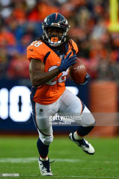 Running back Jamaal Charles of the Denver Broncos rushes against the Cincinnati Bengals at Sports Authority Field at Mile High on November 19 2017 in...