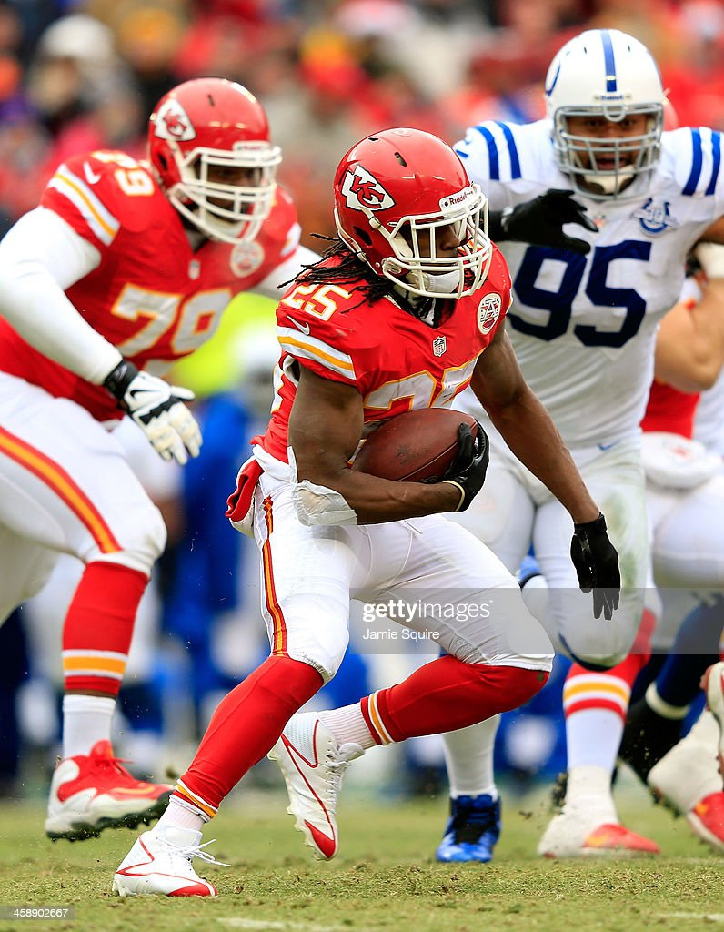 Running back Jamaal Charles #25 of the Kansas City Chiefs carries the ball as defensive end Fili Moala #95 of the Indianapolis Colts chases during the game at Arrowhead Stadium on December 22, 2013 in Kansas City, Missouri.