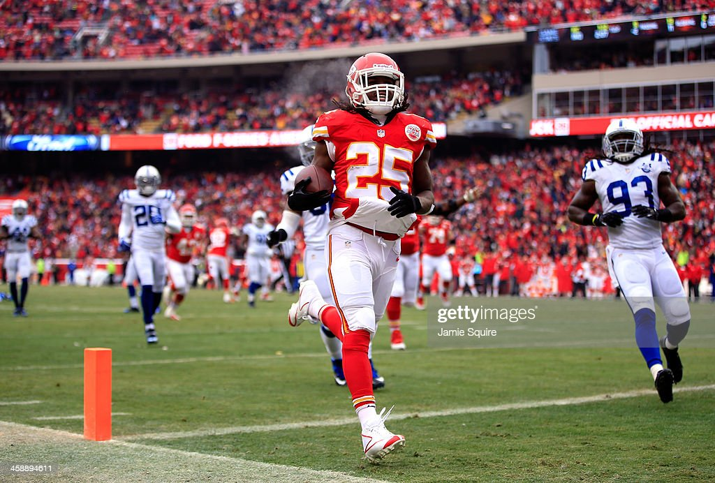 Running back Jamaal Charles #25 of the Kansas City Chiefs carries the ball across the goal line for a touchdwon during the game against the Indianapolis Colts at Arrowhead Stadium on December 22, 2013 in Kansas City, Missouri.