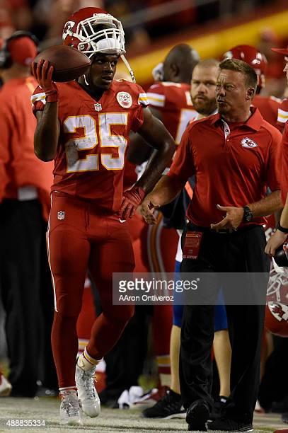 Running back Jamaal Charles of the Kansas City Chiefs holds the ball up after scoring a 70 touchdown against the Denver Broncos during the first half...